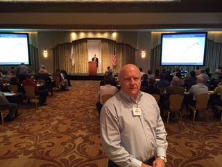 Tom attending a training seminar
